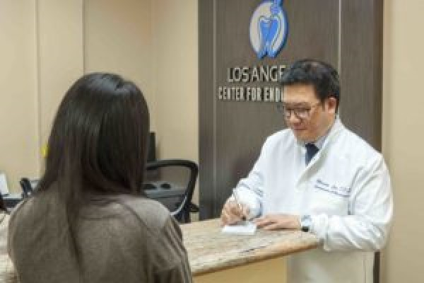 dr. lee giving patient a form